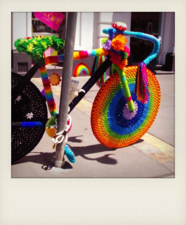 yarn bomb rainbow bike