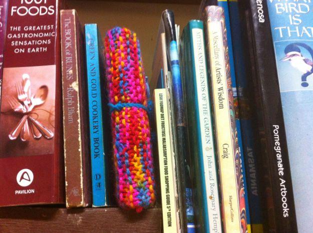 yarn bomb bookshelf