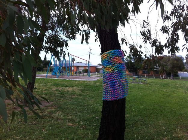 rainbow yarn bombed tree