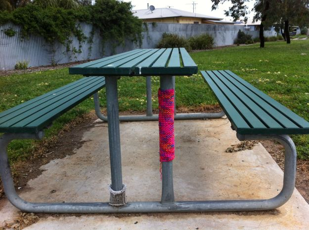 yarn bombed park bench