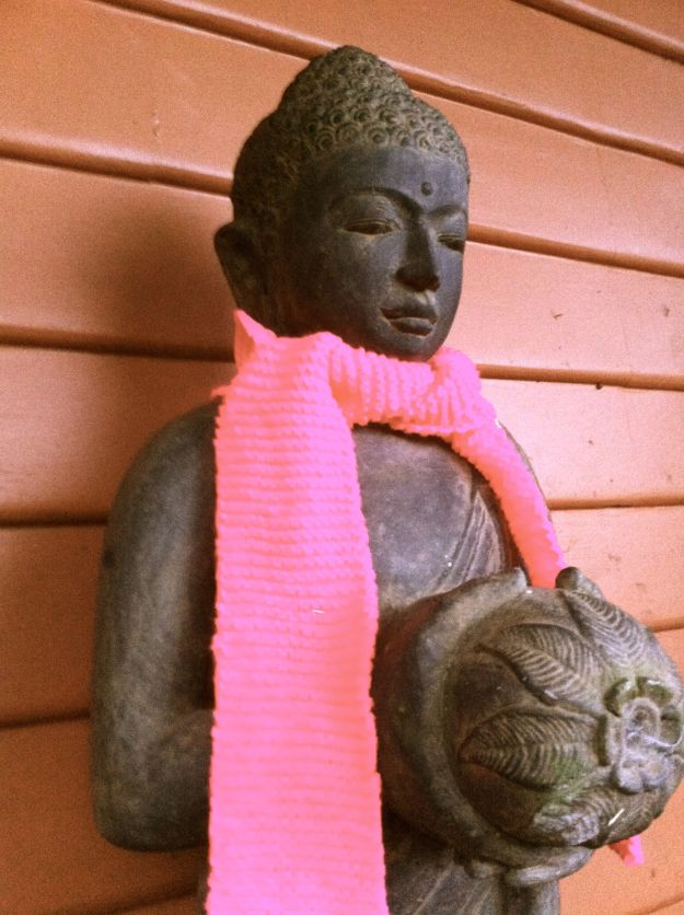 buddha in a yarn bomb scarf 1